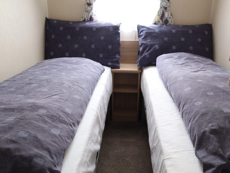 Luxury 8 Berth Caravan twin bedroom