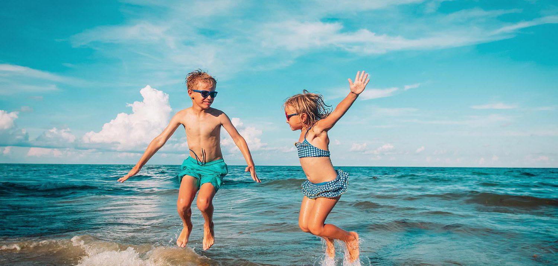Children-Jumping-Beach-Holiday