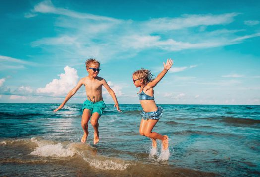 Children-Jumping-Beach-Holiday