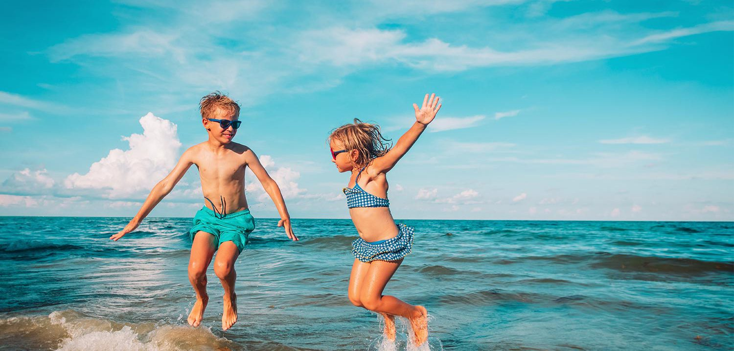 Children-Jumping-Beach-Holiday-Banner